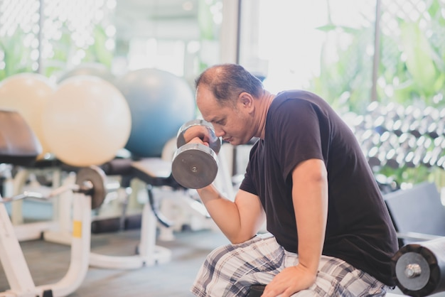Asian man work out exercise at gym weight loss Premium Photo