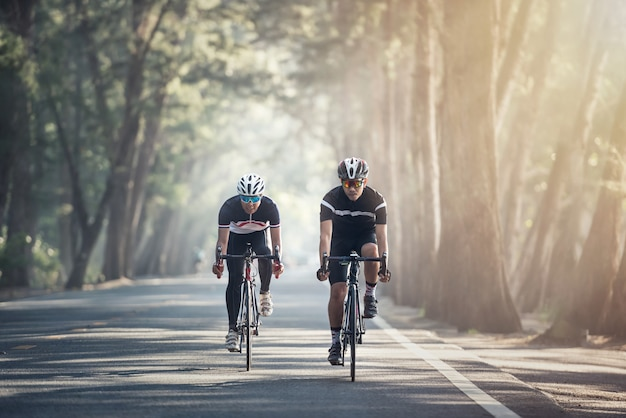 Asian men are cycling road bike in the morning Premium Photo