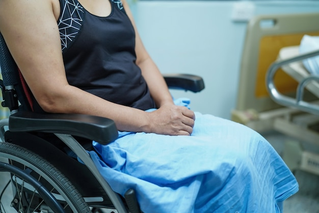 Asian middle-aged lady woman patient on wheelchair in hospital. Premium Photo
