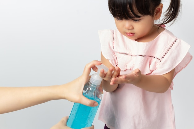 Premium Photo | Asian mom using alcohol antiseptic gel for cleaning baby  hands. coronavirus disinfection