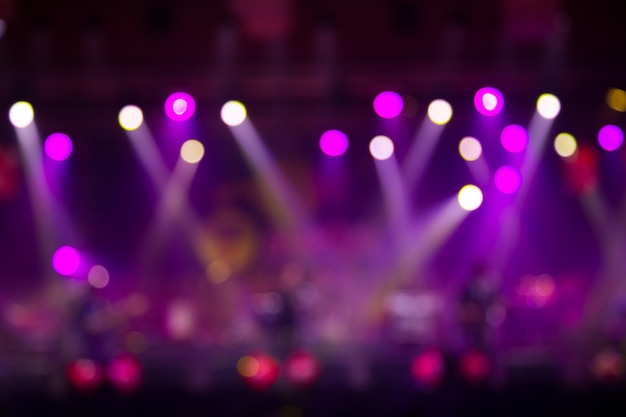 Asian musician playing the guitar on black background with spot light Premium Photo