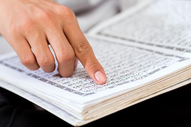 Asian muslim man studying koran or quran Premium Photo