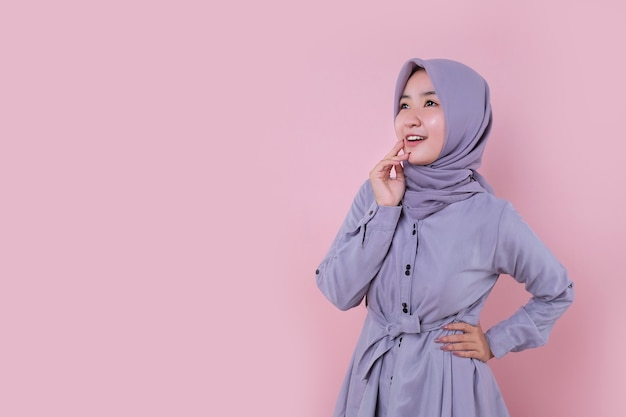 Asian muslim young girl get surprised with soft pink background Premium Photo