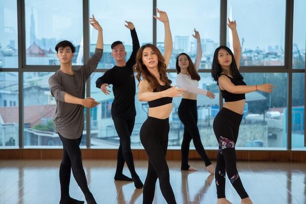 Asian people dancing in studio Free Photo