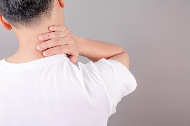 Asian people wear white shirts, feel tired and suffer from neck pain. health concept Premium Photo