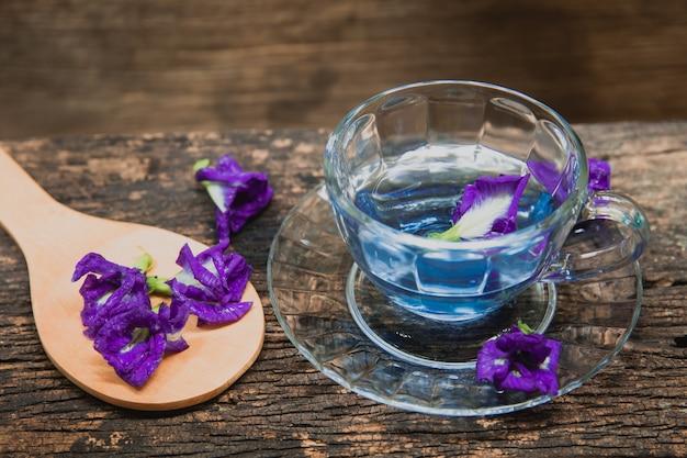 Asian pigeonwings or butterfly pea heabal hot drinking tea refresh thai herb drink on wood Premium Photo