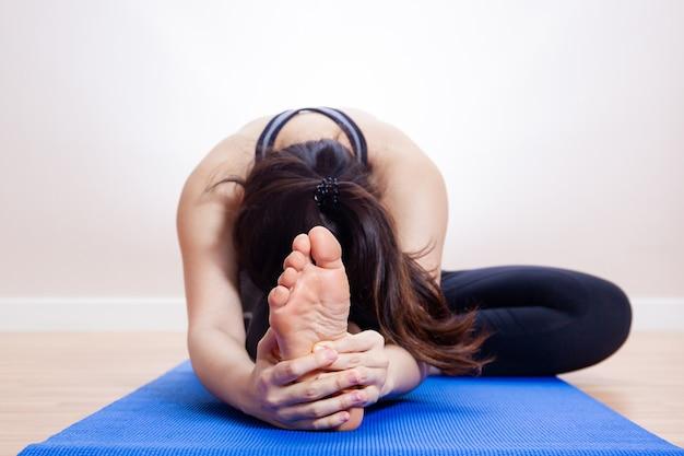 Asian pretty girl doing stretching close up. Premium Photo