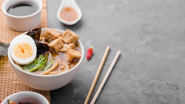 Asian ramen noodle soup with chopsticks Premium Photo