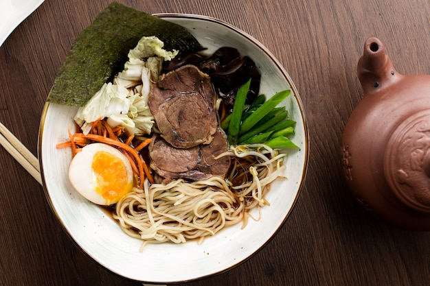 Asian ramen with beef and noodles in a restaurant Premium Photo