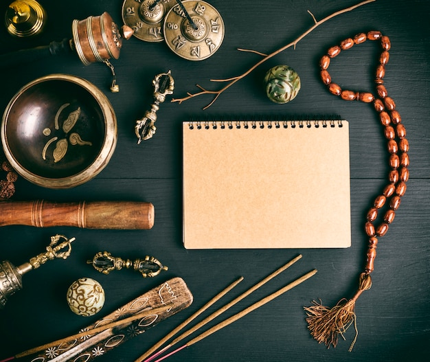 Asian religious musical instruments for meditationnd notebook Premium Photo