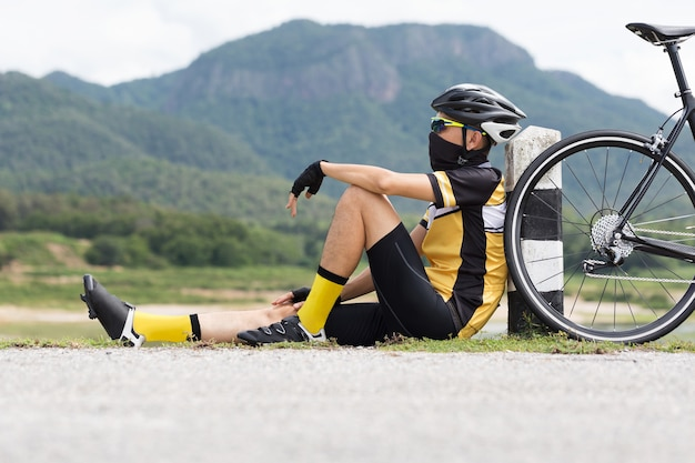 Asian riding man sitting with bicycle with nature background ...