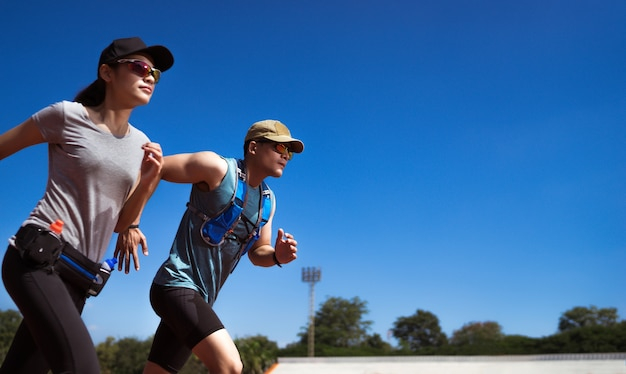 Asian runner are rehearsing jogging, running on the pitch Premium Photo