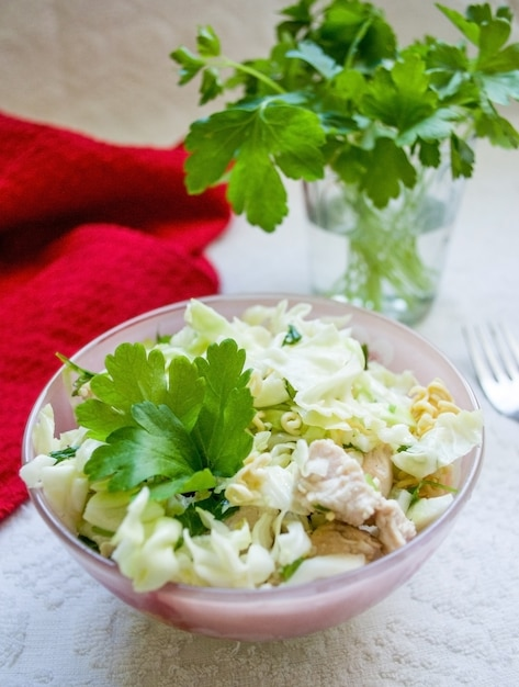 Asian salad with greens and cabbage on light background Premium Photo
