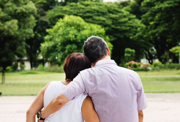 Asian senior couple in the park rear view free image Free Photo