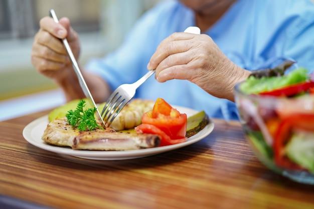 Premium Photo | Asian senior or elderly old lady woman patient eating  salmon salad vegetable breakfast healthy food