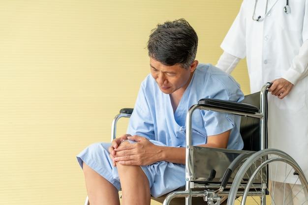 Asian senior patient wheelchair with knee pain Premium Photo