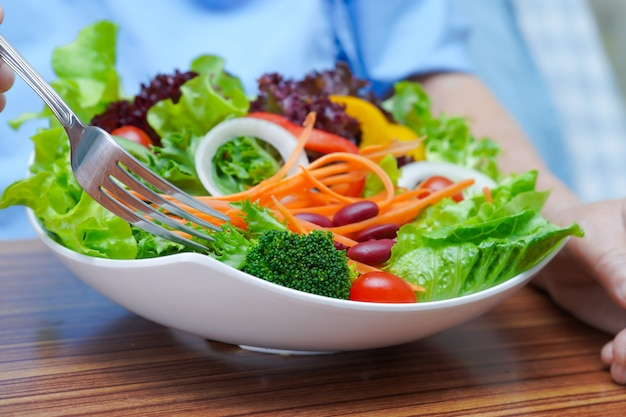 Premium Photo   Asian senior woman patient eating breakfast vegetable healthy  food.