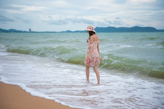 Asian sexy woman walking on the beach, summer holiday travel trip concept. Premium Photo