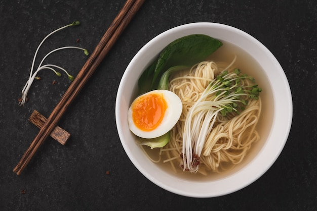 Asian soup noodles (ramen) with egg on dark background Premium Photo
