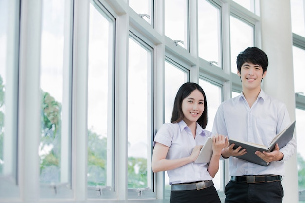 Asian student holding a tablet reading Premium Photo