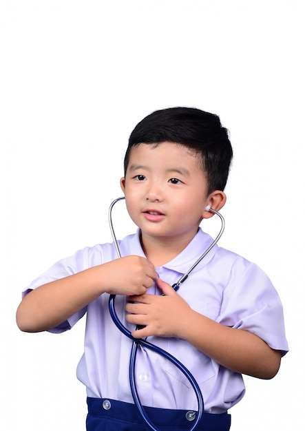 Asian student kid in school uniform playing medical stethoscope isolated Premium Photo