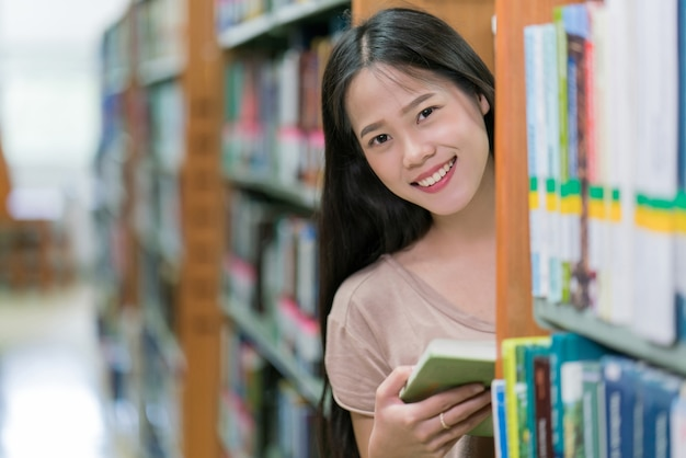 [Image: asian-students-are-reading-book-library_46139-404.jpg]