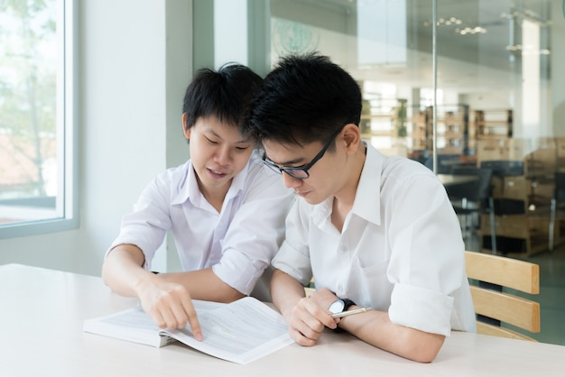 Asian students studying together at university. Premium Photo