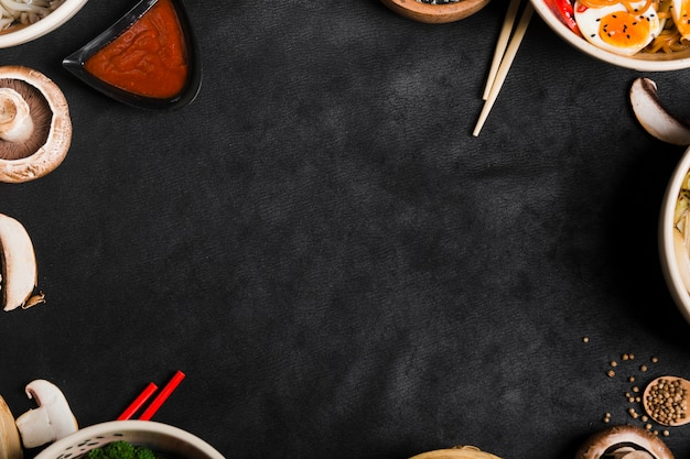 Asian style food bowls with chopsticks and copy space for writing the text Free Photo