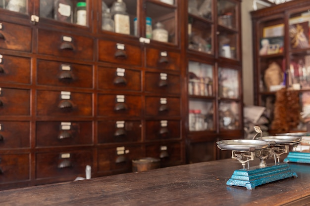 Asian style thai chinese indian herbal traditional herb shop very old with  balance scale on wooden counter Premium Photo