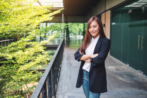Asian successful businesswoman standing in the office Premium Photo