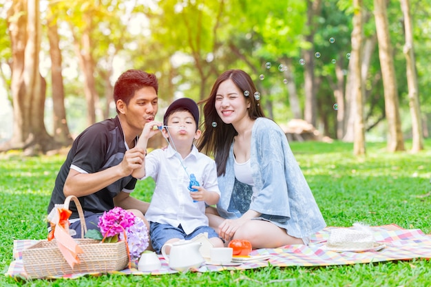 Asian teen family happy holiday picnic moment in the park Premium Photo