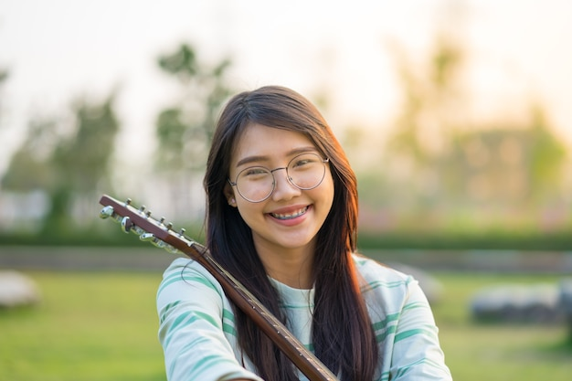 Premium Photo Asian Teen Girls With A Guitar At The Shoulder In The Lawn Sur.ly for joomla sur.ly plugin for joomla 2.5/3.0 is free of charge. https www freepik com profile preagreement getstarted 2126495