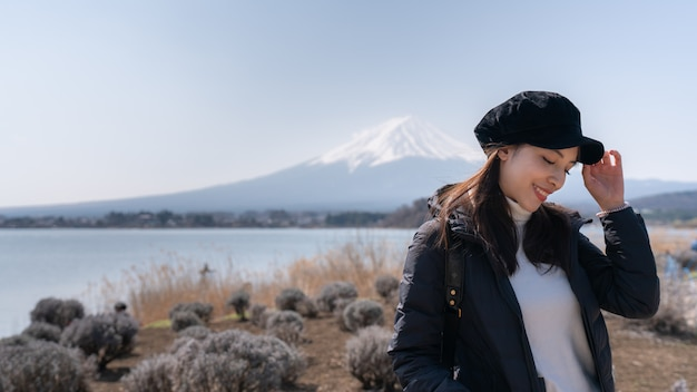 Asian tourists woman feel happy in the field of dry grass Premium Photo