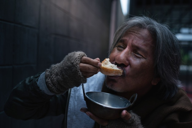 Asian vagrant feel happy with the donated bread and milk. Premium Photo