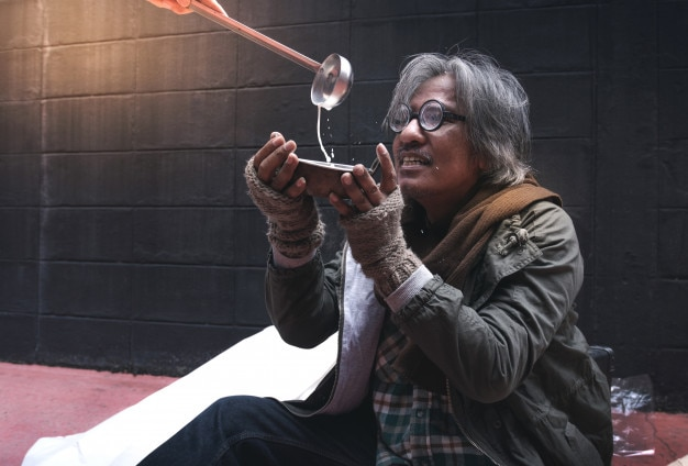 Asian vagrant feel happy with milk put in cup homeless lifestyle Premium Photo