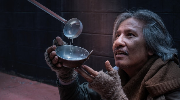 Asian vagrant or hungry homeless feel happy with the donated milk Premium Photo