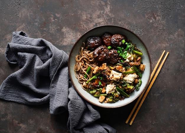Asian vegan soba noodle  with tofu cheese, shiitake mushrooms Premium Photo