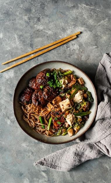 Asian vegan soba noodle  with tofu cheese, shiitake mushrooms, Premium Photo