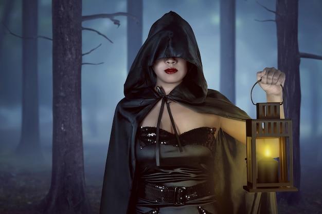 Asian witch woman holding lantern Premium Photo