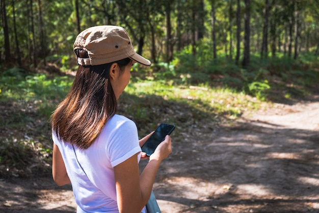 Asian woman checking her phone Premium Photo