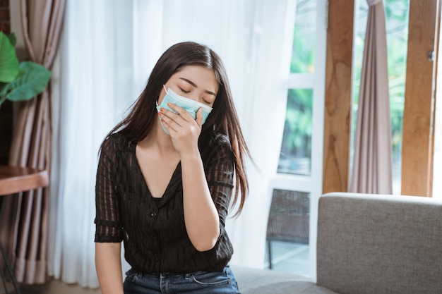 Asian woman coughing at home Premium Photo