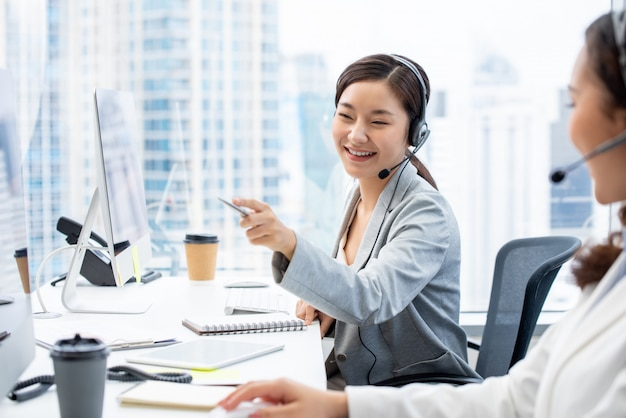 Asian woman customer service agent working in call center office Premium Photo