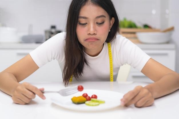 Asian woman eat disorder during diet. Premium Photo