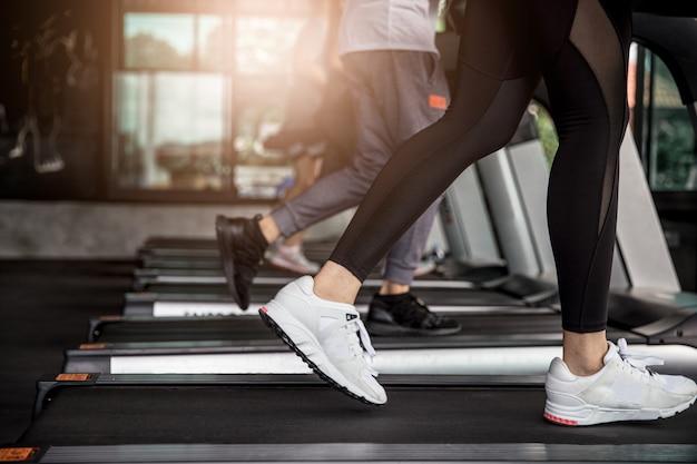 Asian woman exercise running on machine treadmill Premium Photo
