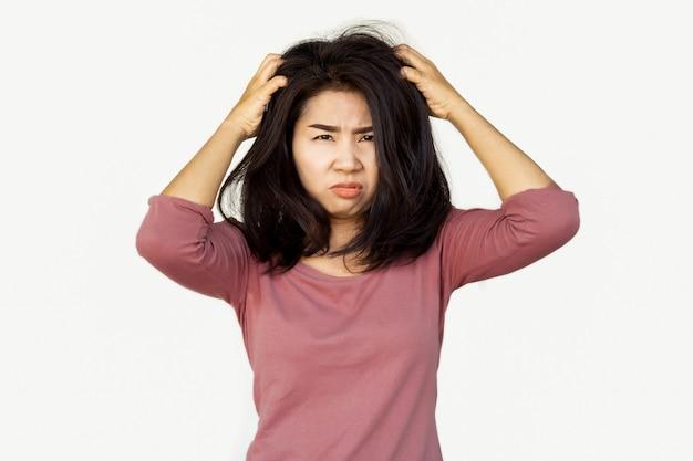 Asian woman hand itching dandruff Premium Photo