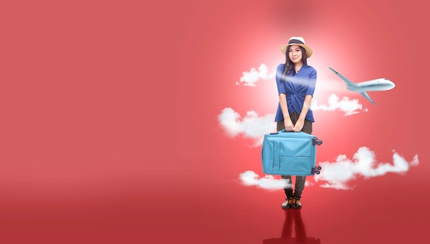 Asian woman in hat with suitcase bag going traveling with airplane background Premium Photo