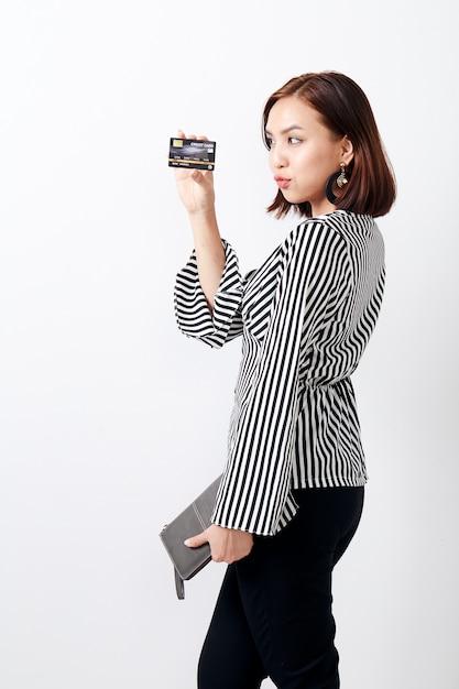 Asian woman holding card Premium Photo