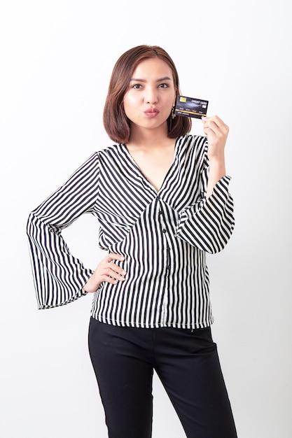 Asian woman holding credit card Premium Photo