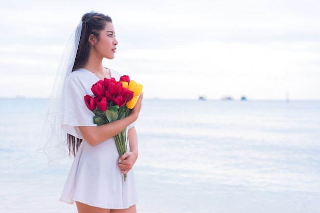 Asian Woman Holding Flowers And Waiting For Someone Make Her Happy