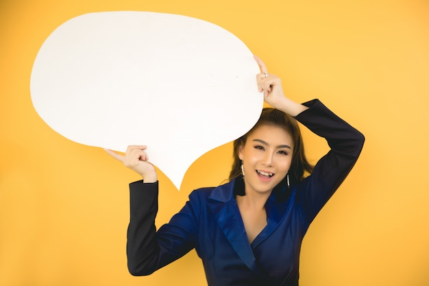 Asian woman holding and looking up to speech bubble with empty space for text Free Photo
